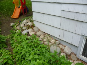 Expose foundation beneath siding